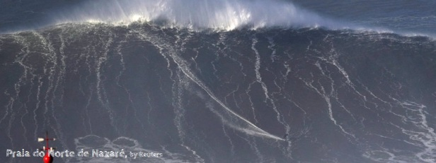 Big wave surfer Sebastian Steudtner of Germany drops in on a large wave at Praia do Norte in Nazare